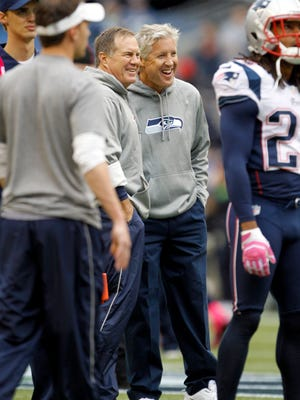 Patriots head coach Bill Belichick (left) and Seahawks head coach Pete Carroll in October of 2012.