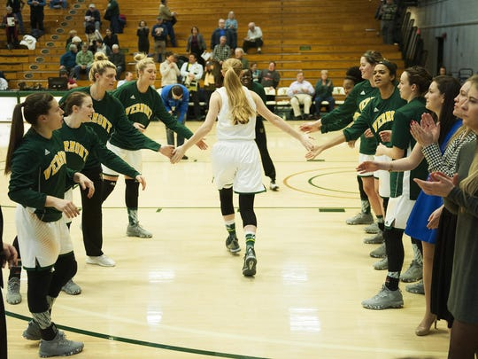 Vermont's Hanna Crymble (10) takes the court during player introductions during the women's basketball game between the Maine Black Bears and the Vermont Catamounts at Patrick Gym on Wednesday night.
