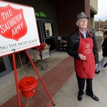 Raymond Boswell rings a Salvation Army bell for charity.