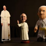 Pope Francis souvenirs at a gift shop at Washington's Basilica of the National Shrine of the Immaculate Conception include statuettes and coffee mugs.