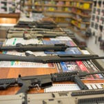 Guns are on display at a gun shop in Roseburg, Oregon, where a lone gunman killed eight students and an instructor on the Umpqua Community College campus.