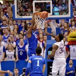Jan 30, 2016; Lawrence, KS, USA; Kentucky Wildcats forward Alex Poythress (22) dunks the ball over Kansas Jayhawks forward Jamari Traylor (31) during the second half at Allen Fieldhouse. Kansas won the game 90-84 in overtime. Mandatory Credit: Denny Medley-USA TODAY Sports