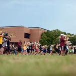 The Pride of Mississippi marching band members practice their routines on campus Thursday. The band will perform at the first home USM football game on Sept. 10, 2016.