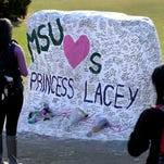 "MSU Head Basketball Coach Tom Izzo leaves a message for 8-year-old ""Princess Lacey"" Holsworth, of St. Johns on The Rock on April 9, the day after the St. Johns 8-year-old died from cancer."