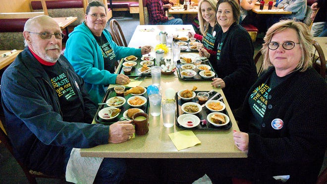 Lloyd Worosz, Vikki Worosz, Deanna Worosz, Margo Arnoske and Debi Zahor enjoy the food at the Garden City Cafe. Their tastings include broasted chicken, chicken marsala, stuffed french toast, pulled pork, mostaccioli and chili. Garden City Cafe was voted the favorite for this year's Taste Fest.