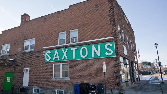 The old Saxtons building, originally called Jewell & Blaich Hall. The building, from the 1920s, originally housed a plumbing business on the first floor and a dance hall and meeting area on the second. A bid by the Downtown Development Authority to tear down the building, and two others on the property, to make way for a parking lot were halted Wednesday by the Historic District Commission.