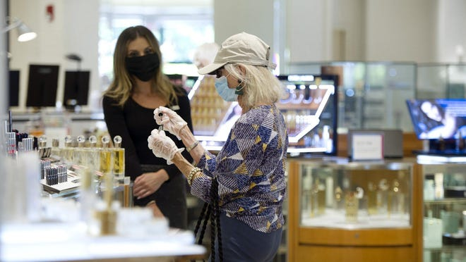 Two women at Saks Fifth Avenue on Worth Avenue recently were wearing masks and other protections, as recommended by the CDC to stem infections from the coronavirus.