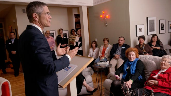 Mark Schauer speaks to local people at the home of Natalie and Bob Mosher of Canton.
