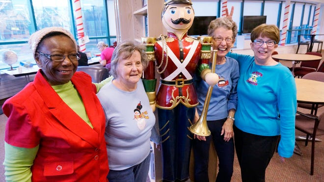 Ella Ray (from left), Marlene Griggs, Virginia Garner and Gloria Cifaldi pose inside the Canton Senior Center after talking about Christmases past.