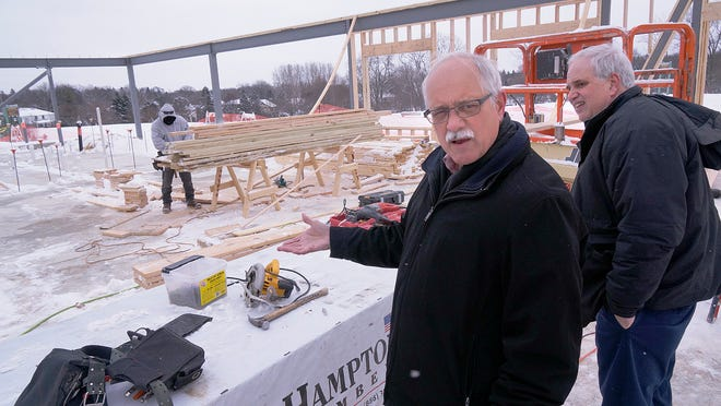 Supervisor Richard Reaume (left) and Treasurer Ron Edwards are upbeat about the progress on the pavilion under construction at Plymouth Township Park.