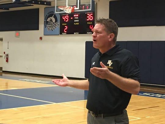 Bishop Verot coach Matt Herting gestures to his players