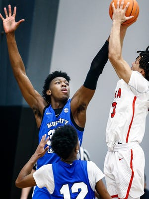 Bluff City Legends center James Wiseman (left) applies defensive pressure to PSA Cardinals guard Cole Anthony (right) during their Nike EYBL game in Dallas, Texas.
