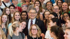 Minnesota Sen. Al Franken poses with visiting students