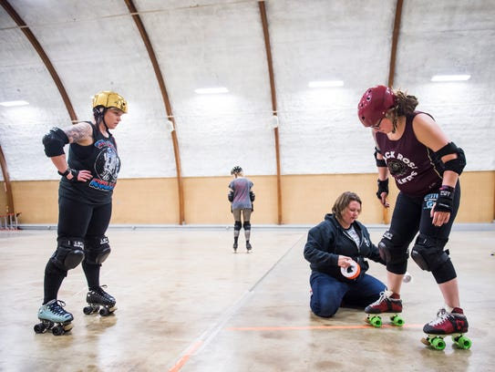 "Black Rose Rollers Lacey ""Bio-Hazard"" Adams, right,"