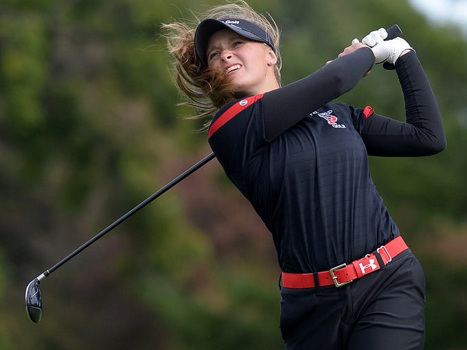 Penfield's Abby Ottman watches her tee shot on the