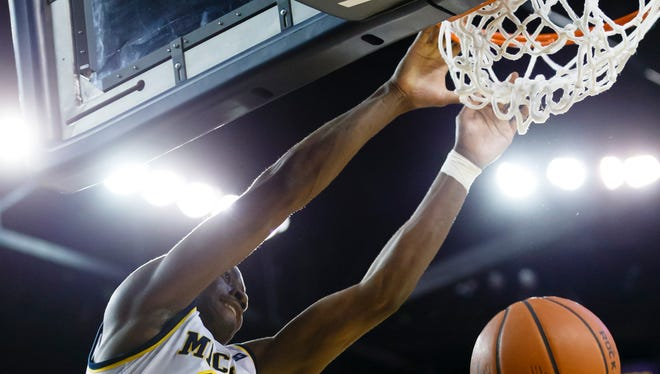 Michigan guard Caris LeVert (23) dunks in the first half against the Houston Baptist Huskies at Crisler Center Saturday.