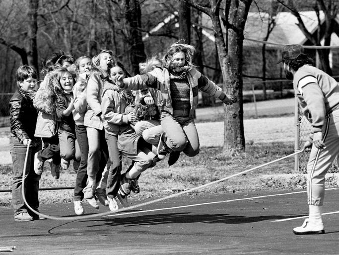 Billy Robinson, right, physical education teacher, helps Chip Grisham, left, twirl a jump rope for third and fourth graders in the physical education class at the Lord's Chapel Christian Academy March 1, 1984. The School is located at the intersection of Granny White Pike and Old Hickory Boulevard.