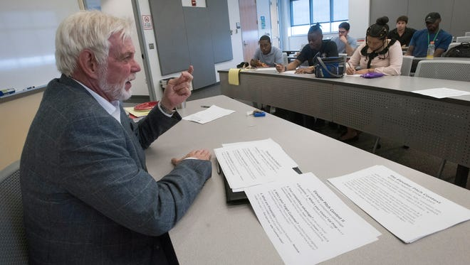 University of West Florida professor Bob Perkins meets with a group of students Wednesday, Feb. 21, 2018, during a workshop to help the future entrepreneurs formulate ideas for UWF's Elevator Pitch contest.