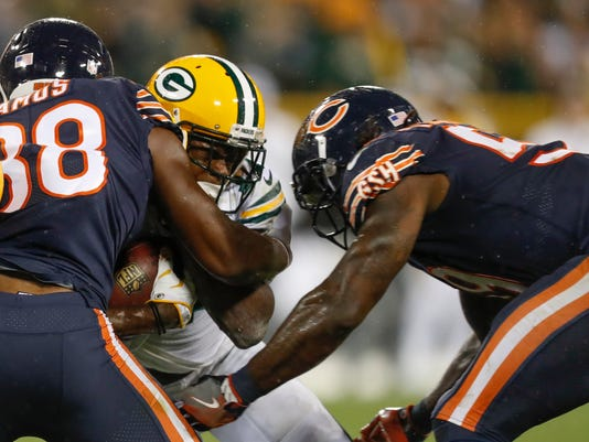 Green Bay Packers' Davante Adams is hit by Chicago Bears' Adrian Amos and Danny Trevathan during the second half of an NFL football game Thursday, Sept. 28, 2017, in Green Bay, Wis. The Bears were penalized on the play and Adams was taken off the field on a stretcher. (AP Photo/Matt Ludtke)