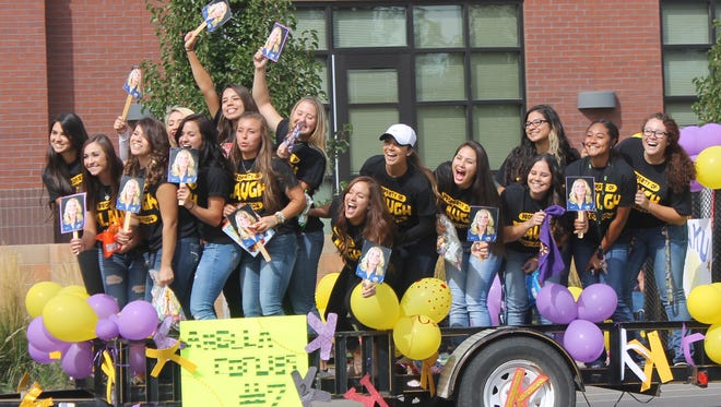 WNMU's Softball team rides the float with Mustang Spirit at Saturday's homecoming parade.