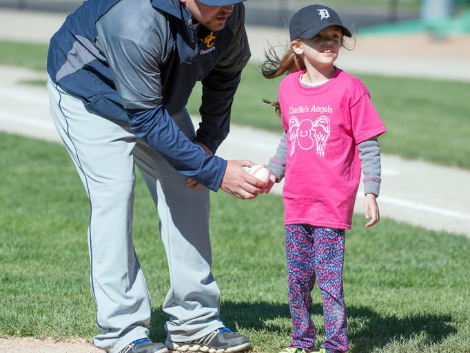 Charlie Buckley, 6, receives the game ball as she gets
