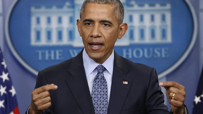 President Barack Obama speaks during his final presidential news conference at the White House.