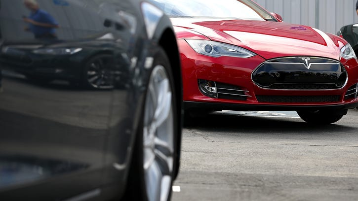 Justin Sullivan, Getty Images [WireImage] FREMONT, CA - AUGUST 16:  Tesla Model S sedans are seen parked in front of the Tesla Factory on August 16, 2013 in Fremont, California. Tesla Motors opened a new Supercharger station with four stalls for public use at their factory in Fremont, California. The Superchargers allow owners of the Tesla Model S to charge their vehicles in 20 to 30 minutes for free. There are now 18 charging stations in the U.S. with plans to open more in the near future.  (Photo by Justin Sullivan/Getty Images) ORG XMIT: 176932554