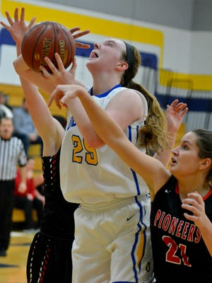 Oconto's Mara Allen scores 2 of her game-high 30 points in a January game against  Sevastopol.