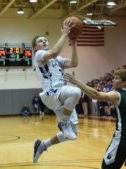Chatham senior guard Mac Bredahl drives to the basket