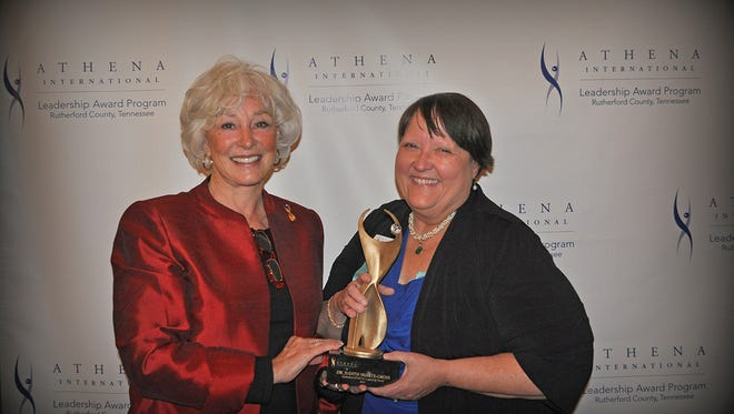 MTSU chemistry professor and WISTEM Center Director Judith Iriarte-Gross, right, receives the ATHENA International Leadership Award from Martha Mayhood Mertz, the organization's founder and speaker at the May 15 Rutherford ATHENA event at Stones River Country Club. (Photo by Cynthia Jones Photography)