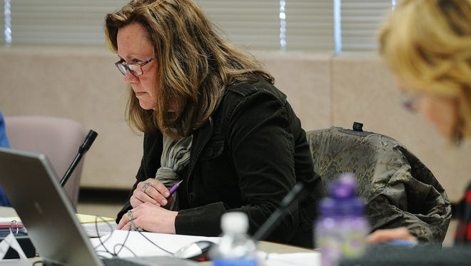 Lorie Hogstad, committee member, looks on during the Minnehaha County Election Review meeting on Friday, March 6, 2015, at the Minnehaha County Administration Building in Sioux Falls, S.D.
