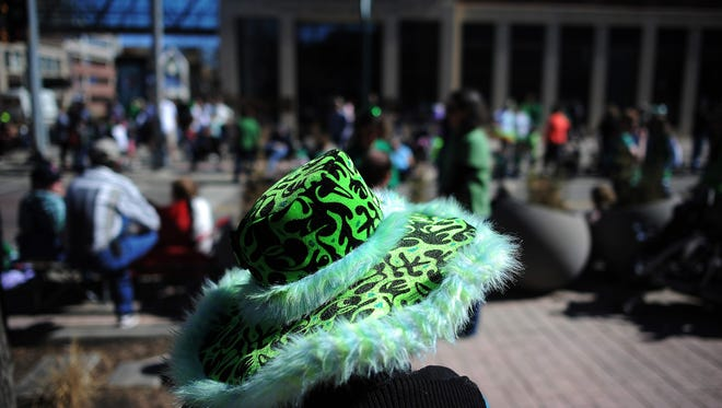 "Ardell Johnson, of Valley Springs, S.D., sports a green hat while waiting for the start of the 36th annual St. Patrick's Day Parade on Saturday, March 14, 2015, through downtown Sioux Falls, S.D. Johnson said that she's been to the St. Patrick's Day Parade in all kinds of weather, including snow and cold. ""It's frosting on the cake to have this nice weather,"" Johnson said."