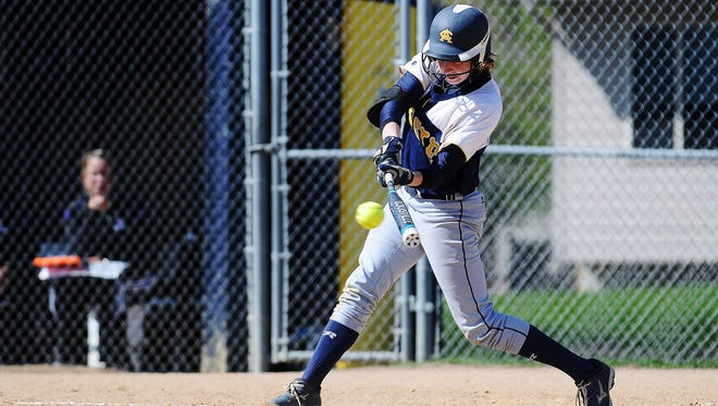 Augustana's Sarah Kennedy (32) hits a double driving two runs in during the first game of a doubleheader against Winona State on Wednesday, April 22, 2015, at Bowden Field on the Augustana College campus in Sioux Falls.