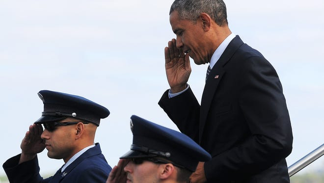 President Barack Obama exits Air Force One at the Watertown Regional Airport during a visit to speak at Lake Area Technical Institute commencement on Friday, May 8, 2015, in Watertown, S.D.