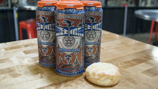 "Biscuit, the man behind the ""Tom Brady Sux"" beer cans didn't want photographed. So Sun King gave us this photo."