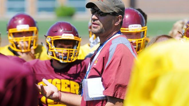 Harrisburg head football coach Brandon White talks with his team during a practice Thursday, Aug. 20, 2015, at Harrisburg High School in Harrisburg, S.D.