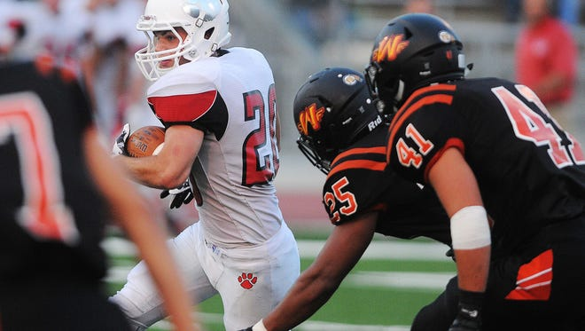 Brandon Valley's Chase Grode (20) carries the ball during a game against Washington Friday, Aug. 28, 2015, at Howard Wood Field in Sioux Falls.