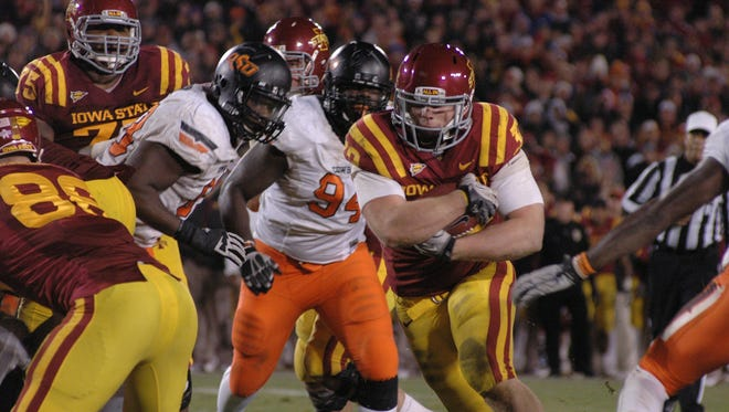 Iowa State's Jeff Woody crosses the goal line for the game-winning touchdown in the second overtime to give the Cyclones a 37-31 victory over second-ranked Oklahoma State at Jack Trice Stadium in 2011.