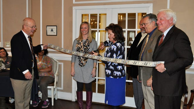Simpsonville Mayor Janice Curtis cuts the ribbon at a dedication ceremony for a new wing of The Springs at Simpsonville senior living community.
