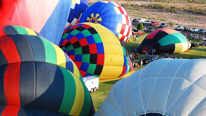 Headlight File PhotoThe colorful hot air balloons as seen from above.
