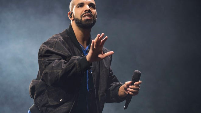 FILE - In this Oct. 8, 2016 file photo, Drake performs onstage in Toronto. Drake leads the nominations for the 2017 iHeartRadio Music Awards with 12, including male artist of the year, announced Wednesday, Jan. 4, 2017. (Photo by Arthur Mola/Invision/AP, File)