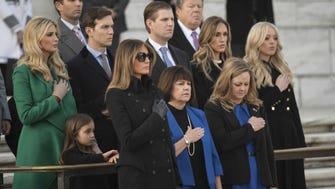 Ivanka Trump, (l), Jared Kushner, Donald Trump Jr., Melania Trump (center left) and Tiffany Trump (far right) are among Trump family members at a wreath-laying ceremony at Arlington National Cemetery on Jan. 19, 2017.