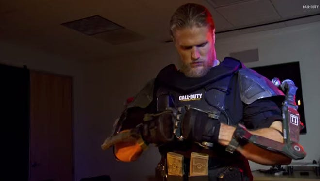 Green Bay Packers linebacker Clay Matthews tries on an exo suit as an intern at Sledgehammer Games, the developer of Call of Duty: Advanced Warfare.
