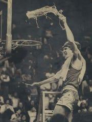 Laurel County's Teel Bruner waves the net in celebration in 1982.