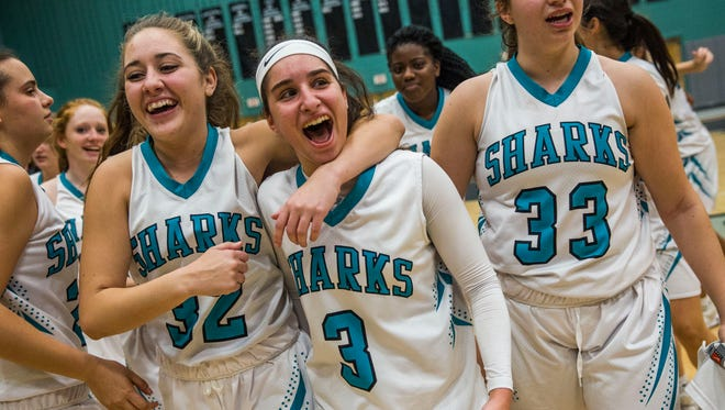 From left, Gulf Coast senior Nycela Guevara, sophomore Mya Giusto, and sophomore Marina Hodo celebrate after winning the Class 8A regional semifinal at Gulf Coast High on Tuesday, Feb. 14, 2017. Gulf Coast beat Lakewood Ranch in overtime with a final score of 72-66.