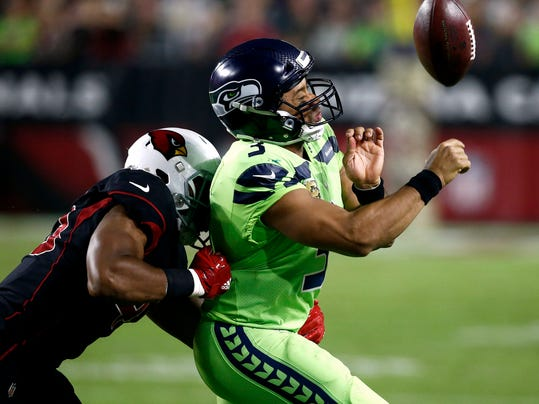 Seattle Seahawks quarterback Russell Wilson (3) loses the ball out of bounds as he is hit by Arizona Cardinals inside linebacker Haason Reddick (43) during the second half of an NFL football game, Thursday, Nov. 9, 2017, in Glendale, Ariz. (AP Photo/Ross D. Franklin)