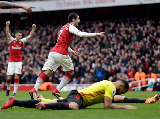 Arsenal's Henrikh Mkhitaryan celebrates after scoring his side's third goal during the English Premier League soccer match between Arsenal and Watford at the Emirates stadium in London, Sunday, March 11, 2018. (AP Photo/Matt Dunham)