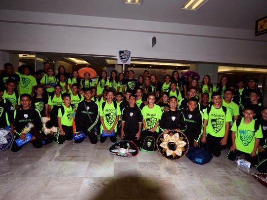 Members of the Mexico Intercup team pose for a picture on their way to Sweden to play in the Gothia Cup.