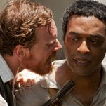 "Chiewetel Ejiofor (right) and Michael Fassbender in ""12 Years a Slave."""