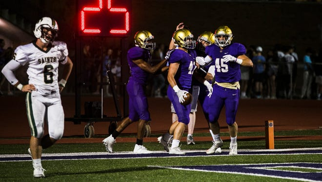 September 29, 2017 - Teammates from the Christian Brothers High School football team gather around Porter Bird (47) after he scored a touchdown against Briarcrest Christian School in the second quarter at CBHS on Friday.